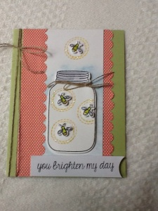 die cut jar and fireflies
