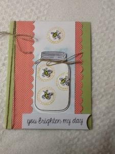 die cut jar and fireflies