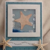 Die cut starfish, sequins and bright blue beads complete the look!