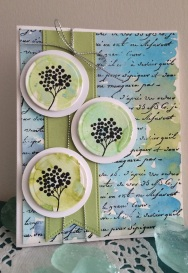A tic tac toe card challenge with circles, background stamp and watercoloring.