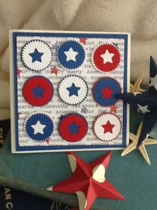 Use punches to create each star emblem for the layout on a square card.