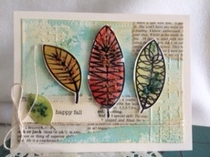 Watercolored leaves create a stunning card